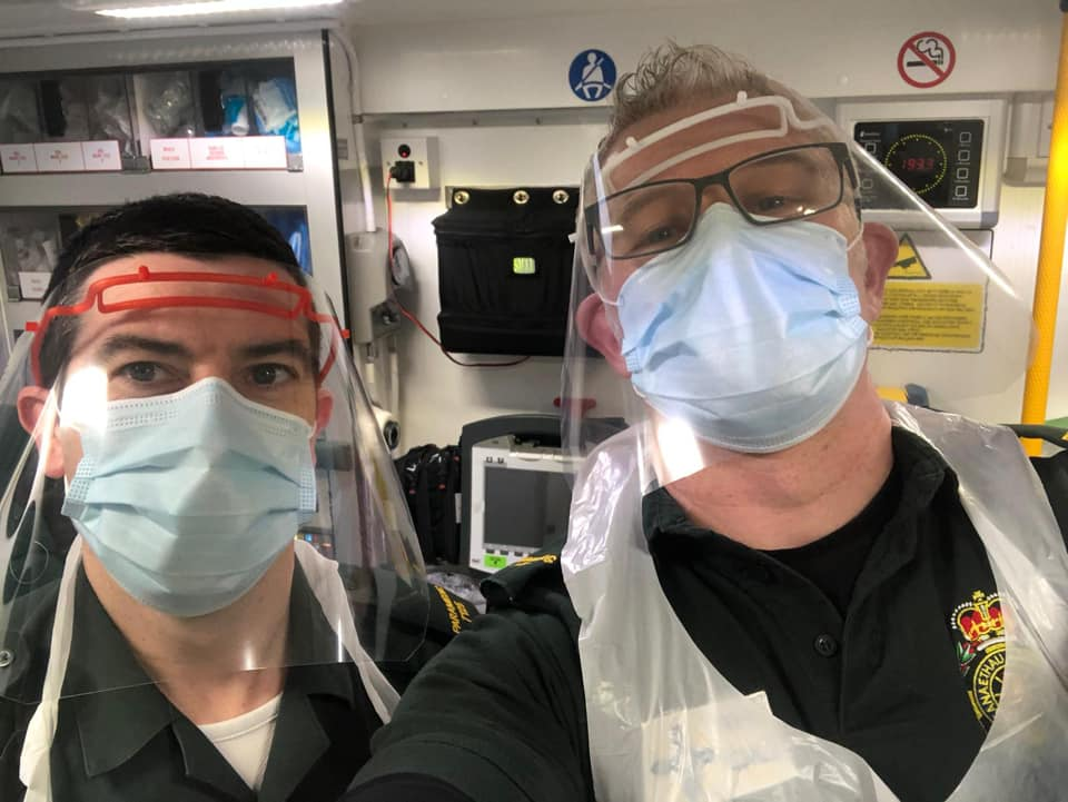 Bridgend Paramedics using the 3D printed face shield. Photo via Scott Dewey.
