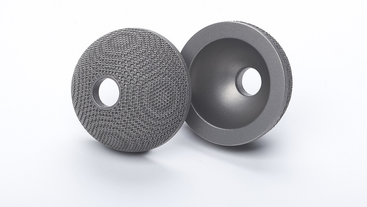 Acetabular cup implant in titanium alloy printed with 60-micron layer. Photo via SLM Solutions.