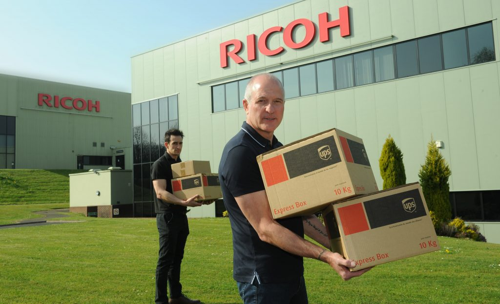 Steve Bull collecting face visors from Ricoh 3D in Telford. Photo via Ricoh 3D.