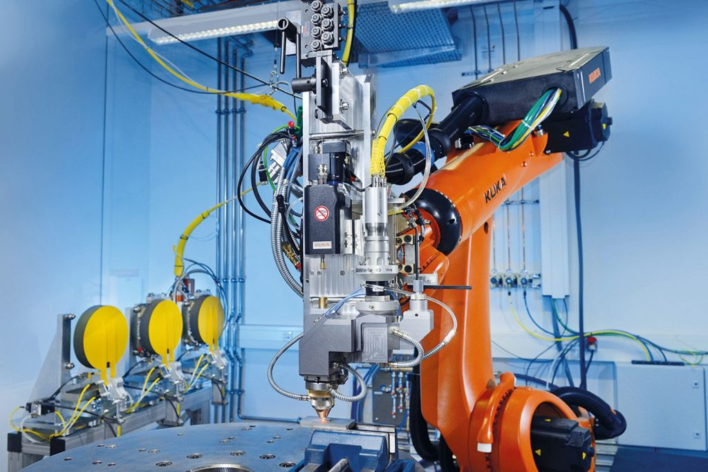Robot research cell depositing wire laser material at Fraunhofer ILT. Photo via Fraunhofer ILT.