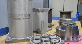 3D printed components for the prototype reactor. Photo via Britanny Cramer/ORNL/US Dept. of Energy.