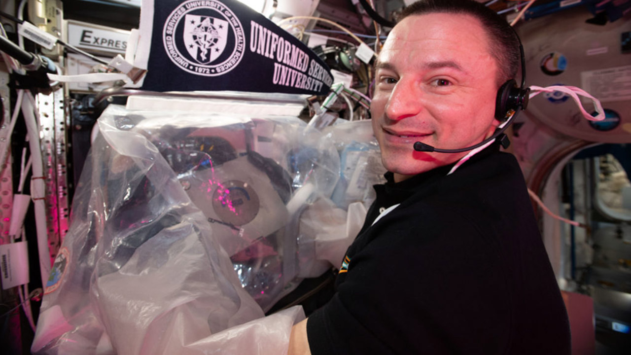 Astronaut Andrew Morgan 3D printing the human knee meniscus in space. Photo via NASA.