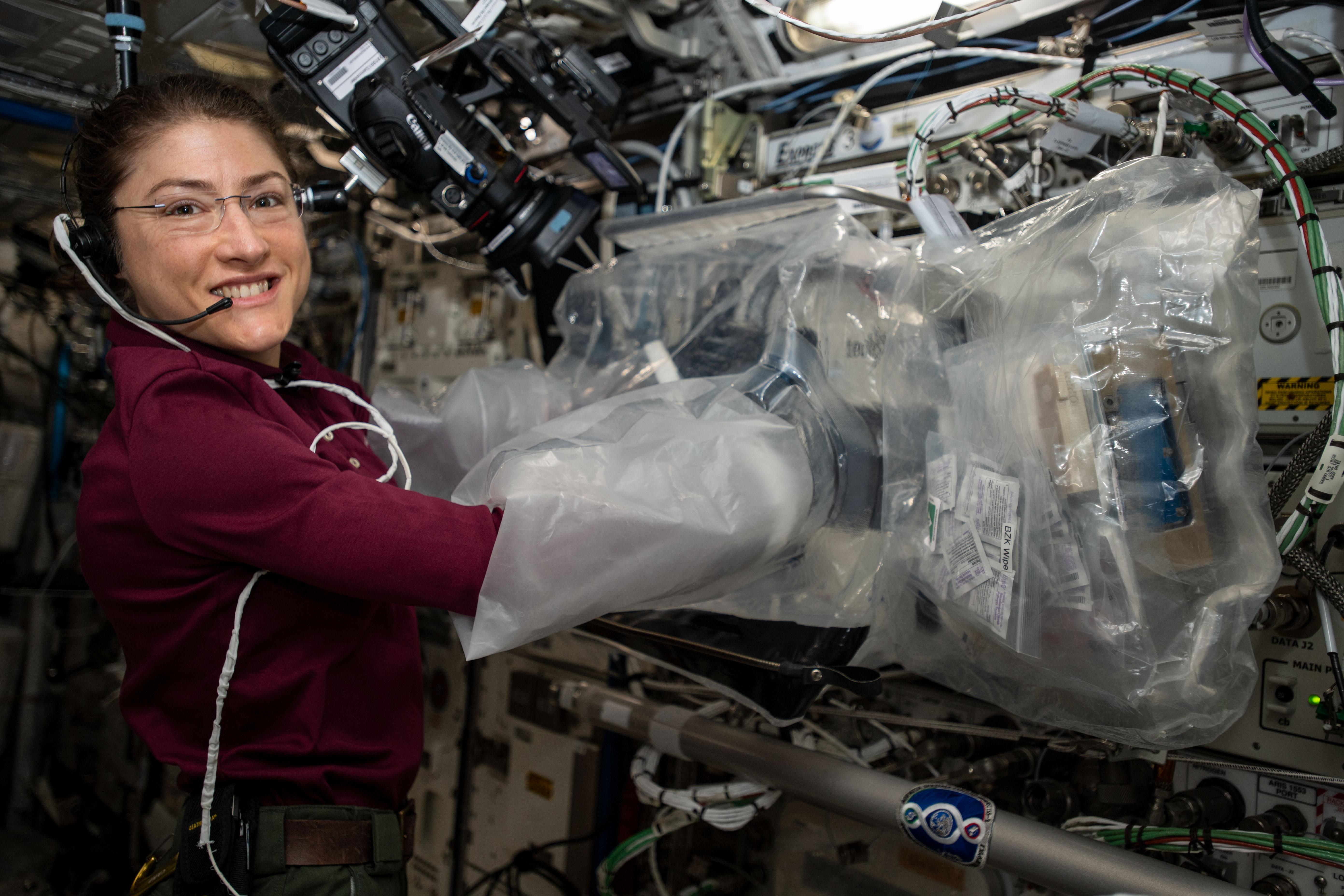 Astronaut Christina Koch operating the 3D BFF, a 3D printer on board the ISS. Photo via NASA.
