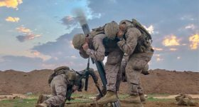 Featured image shows soldiers covering their ears while a mortar is fired. Photo via Sgt. Matthew Crane, US Army.