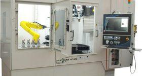 Optomec Huffman DED system with robotic arm. Photo via Optomec.