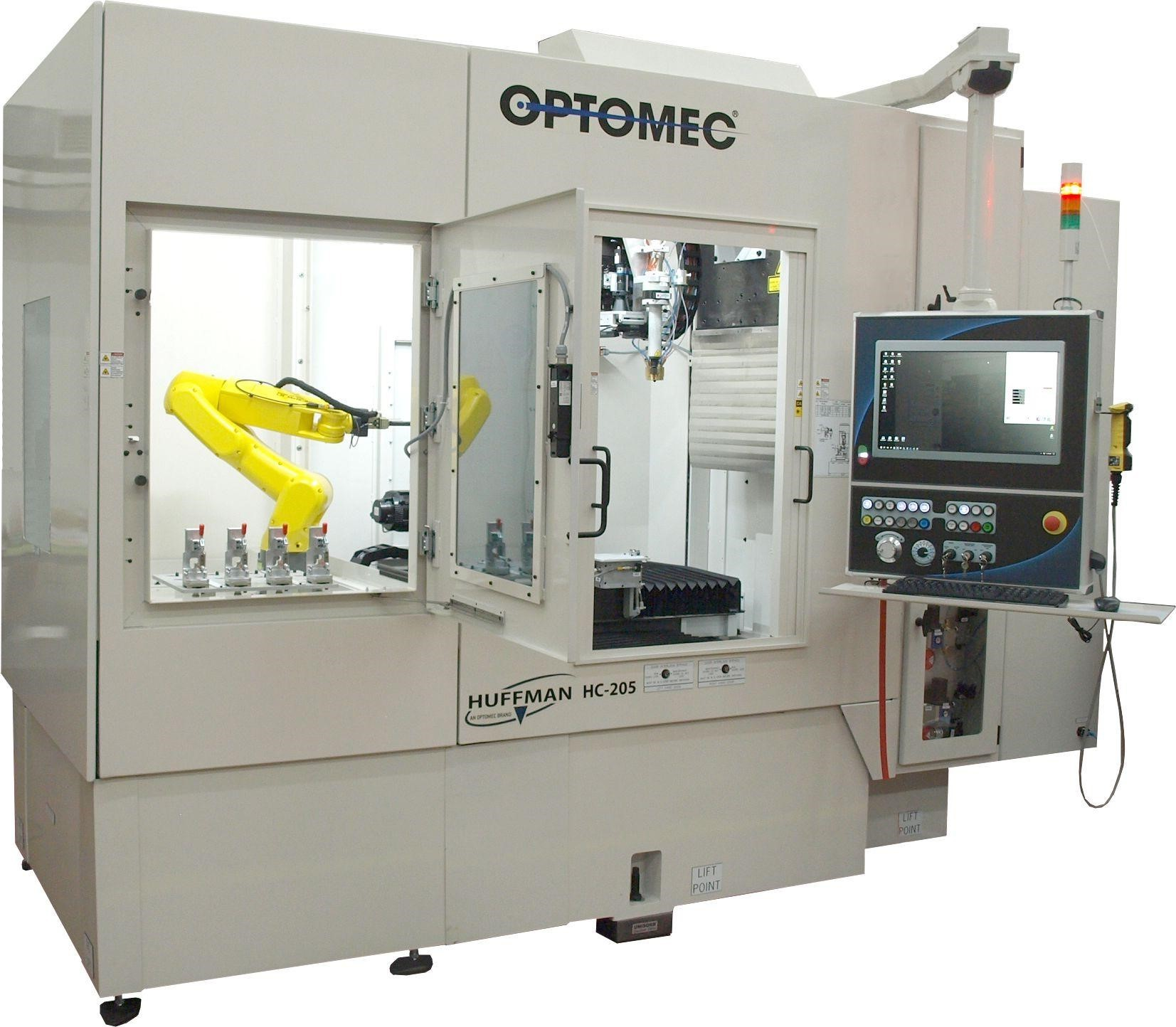 Optomec Huffman DED system with robotic arm. Photo via Optomec.