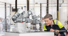 Featured image shows the YuMi 1400 robot being programmed by a test engineer. Photo via ABB Robotics.