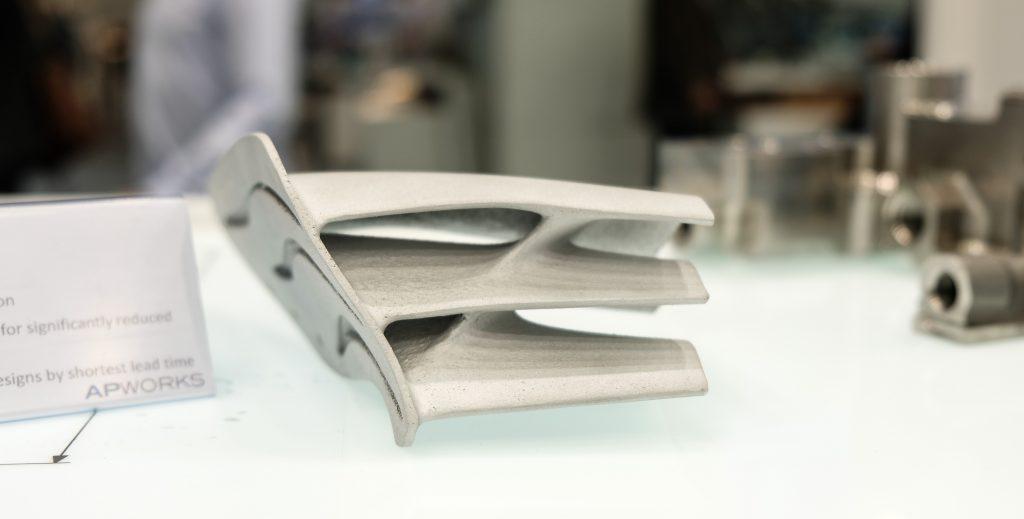Aerodynamic motorsport winglet manufactured out of Scalmalloy. Photo via APWORKS.