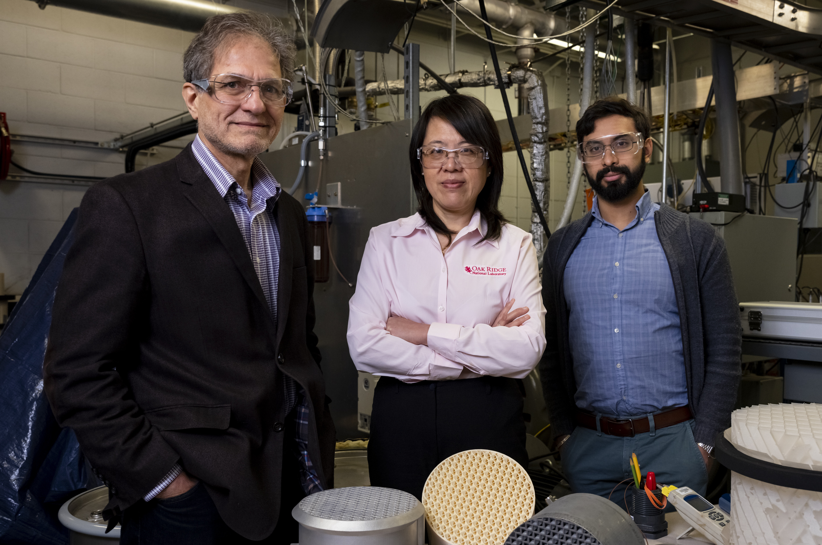 The ORNL researchers (pictured) used 3D printing to optimize their device for carbon dioxide absorbency. Photo via Carlos Jones, ORNL.