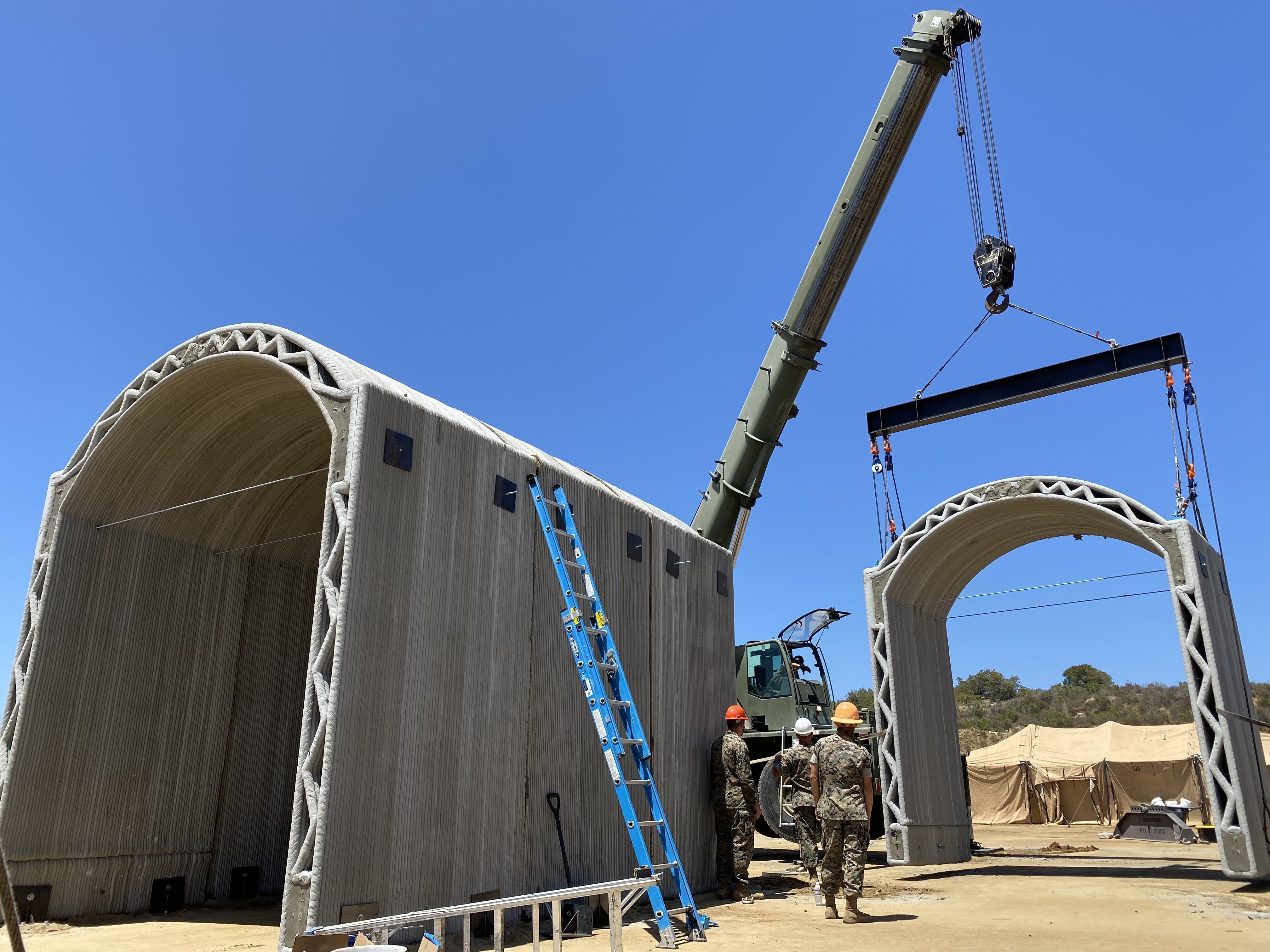 Featured image shows the ICON and US marines' 3D printed concrete vehicle hide structure. Photo via ICON.