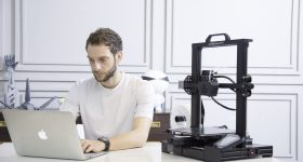 Featured image shows someone using a Creality CR6-SE 3D printer. Photo via Creality.