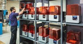 AMRC's printfarm of 12 Formlabs Form 2 3D printers. Photo via AMRC.