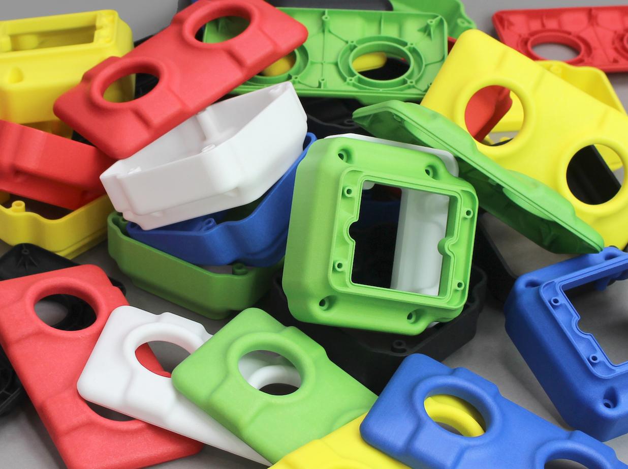 3DPRINTUK's new coloured parts made with DM60 dye machine. Photo via 3DPRINTUK.