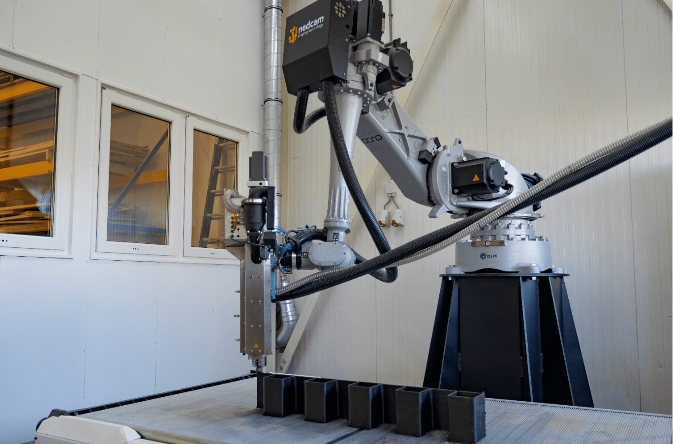 Nedcam has acquired a CEAD AM Flexbot 3D printer (pictured), which it will use to develop new applications for FGF 3D printing technology. Photo via DSM.