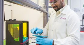 Featured image shows an Evonik scientist working with a 3D printer. Photo via Evonik.