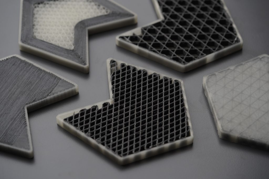 Composite parts 3D printed with the CFC process. Photo via Anisoprint.