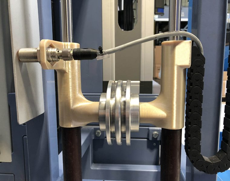 Rustin used its Stratasys Fortus 450mc to create internal production line tooling. The photo above shows weight optimization tool produced in ULTEM™ 9085 resin. Photo via Rustin.