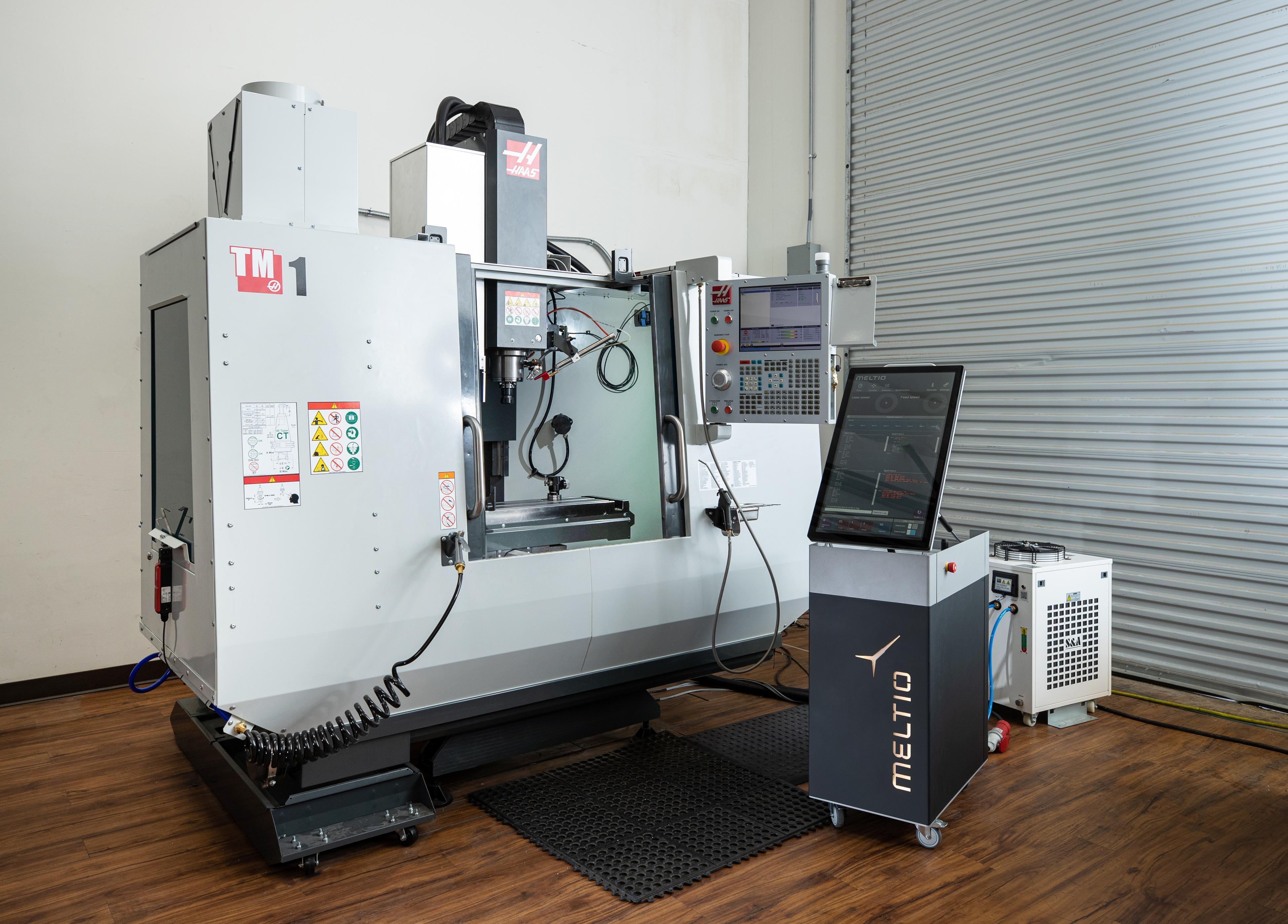 The Meltio Engine integrated with a Haas CNC machine. Photo via Meltio.