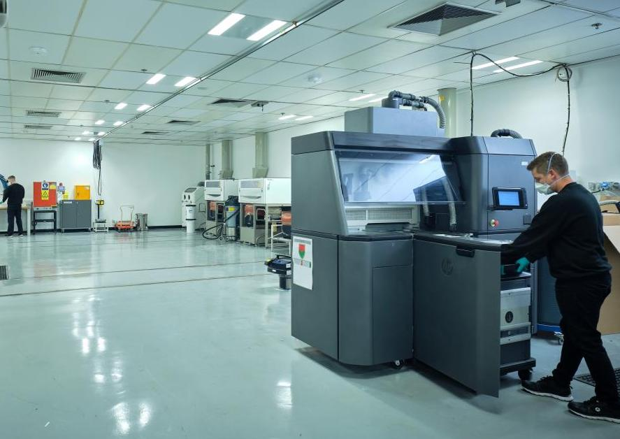 Ricoh's new complex (pictured) is capable of producing medical and automotive parts that meet various ISO testing standards. Photo via Ricoh 3D.