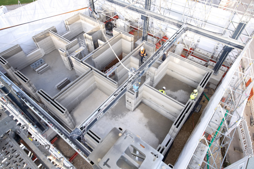 The BOD2 printing the first floor of the three-floor building. Image via COBOD.
