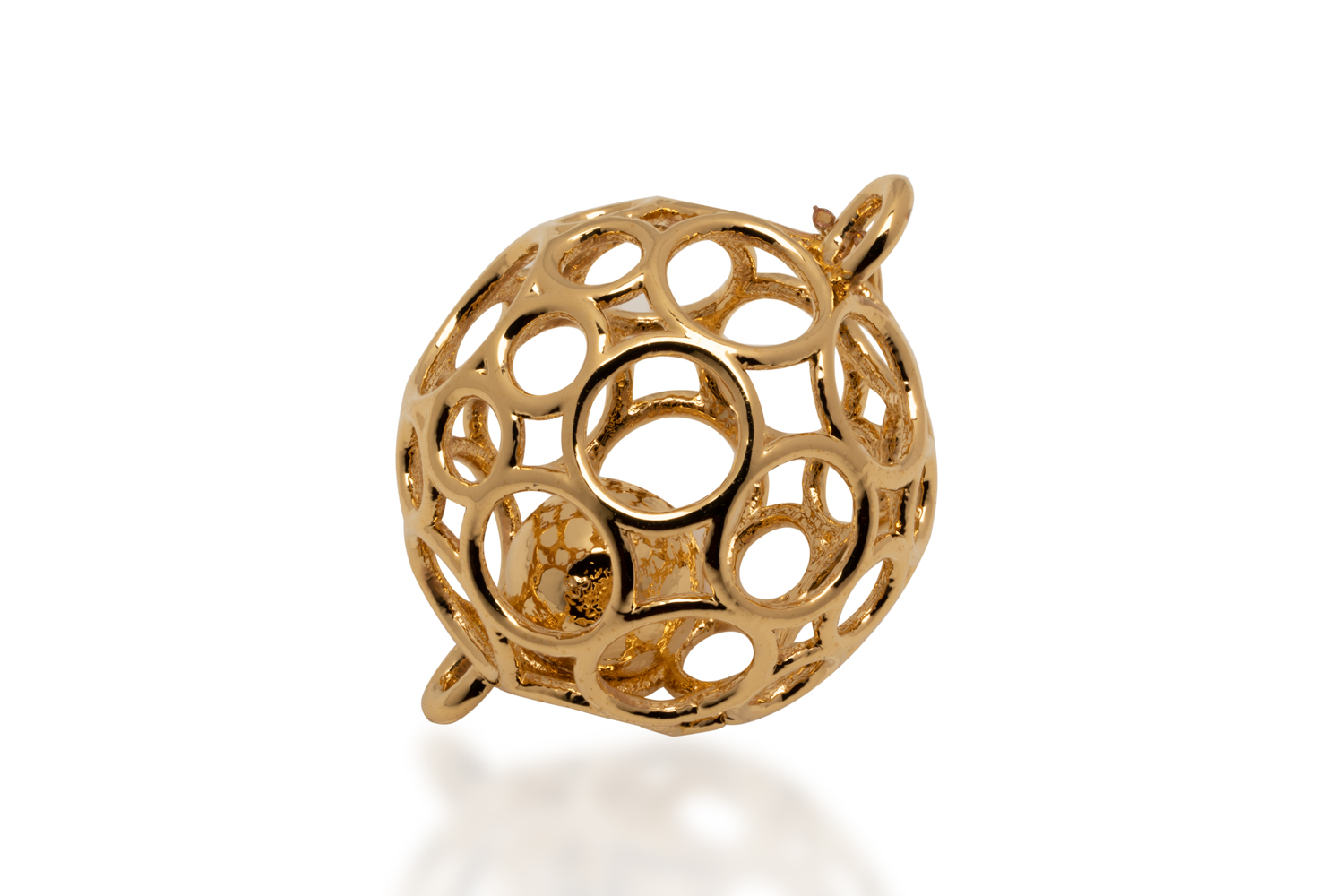 This jewelry ornament, designed by E.A.C., was 3D printed on the Shop System in steel, and subsequently gold-plated. Image via Desktop Metal.