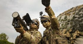 Featured image shows two soldiers testing a missile launcher. Photo via the ARL.
