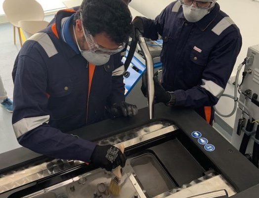 Featured image shows two Immensa engineers producing 3D printed face shields to aid the UAE's fight against COVID-19. Photo via Immensa Technology Labs.
