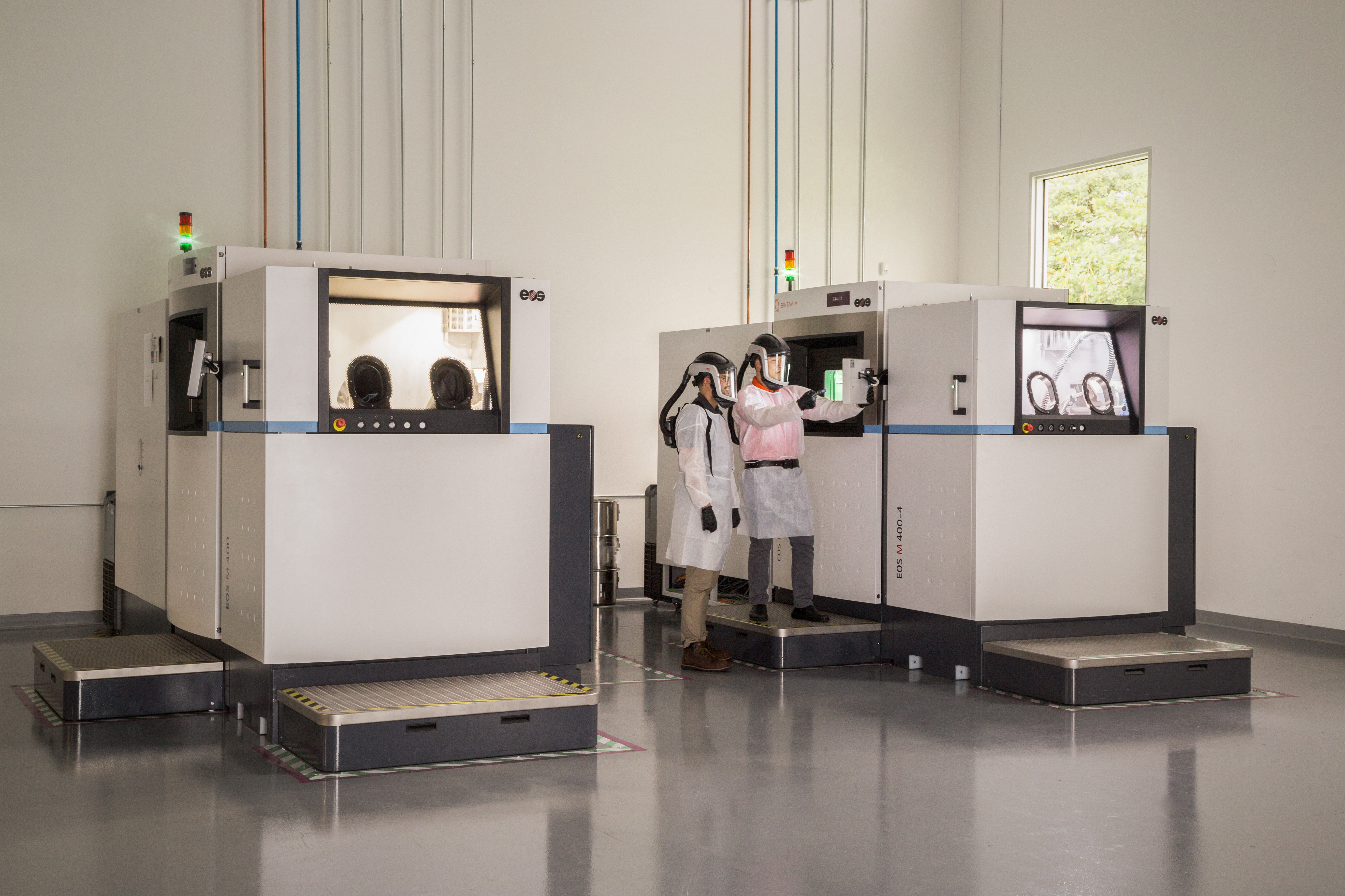 Image shows two of Sintavia's M400 printers at its Hollywood additive manufacturing facility. Photo via Business Wire.