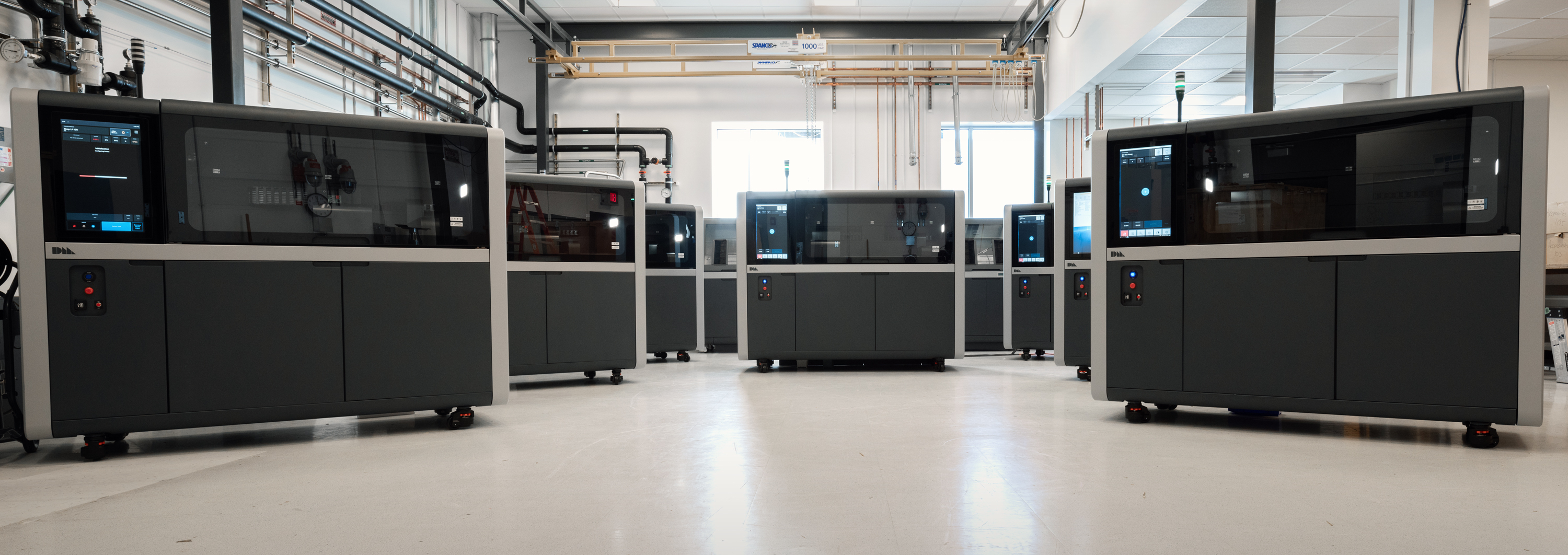 The Shop System can reach speeds of up to 800 cc/hour at 75-micron layer thickness to produce batches of hundreds of printed parts in just five hours. Image via Desktop Metal.