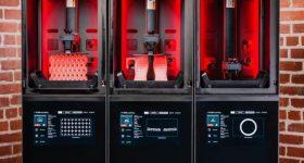 Featured image shows a row of Origin's 'Origin One' SLA 3D printers. Photo via Stratasys.