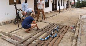Building a test rig for the chlorine doser in 2018 in Uganda. Image via Blue Tap.