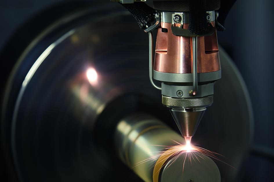 The EHLA head coating a metal part. Photo via Fraunhofer ILT.