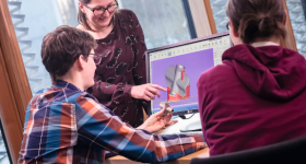 Featured image shows someone being taught a class on 3D modelling. Photo via EOS.
