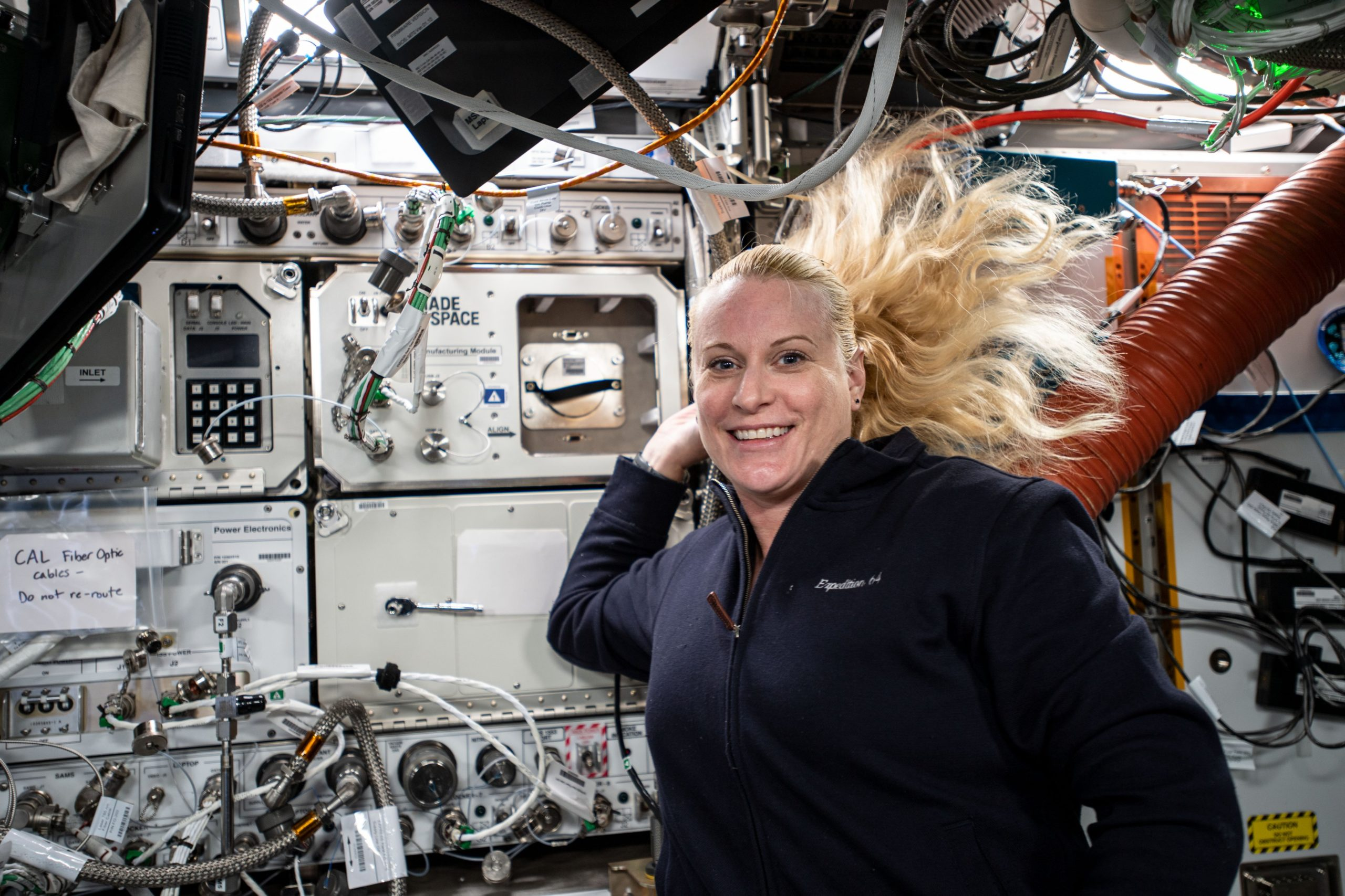 NASA engineer Kate Rubins next to the CMM installed on the ISS. Photo via NASA.