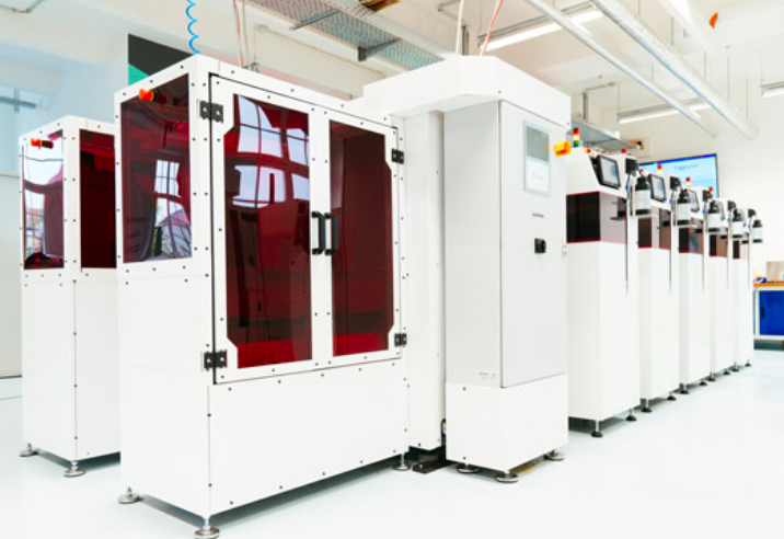 Up to five of the company's new machines can be connected together to form a dental production line. Photo via Rapid Shape.