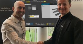 Featured image shows PrintSyst's Itamar Yona and Valuechain's Tom Dawes shaking hands. Photo via PrintSyst.