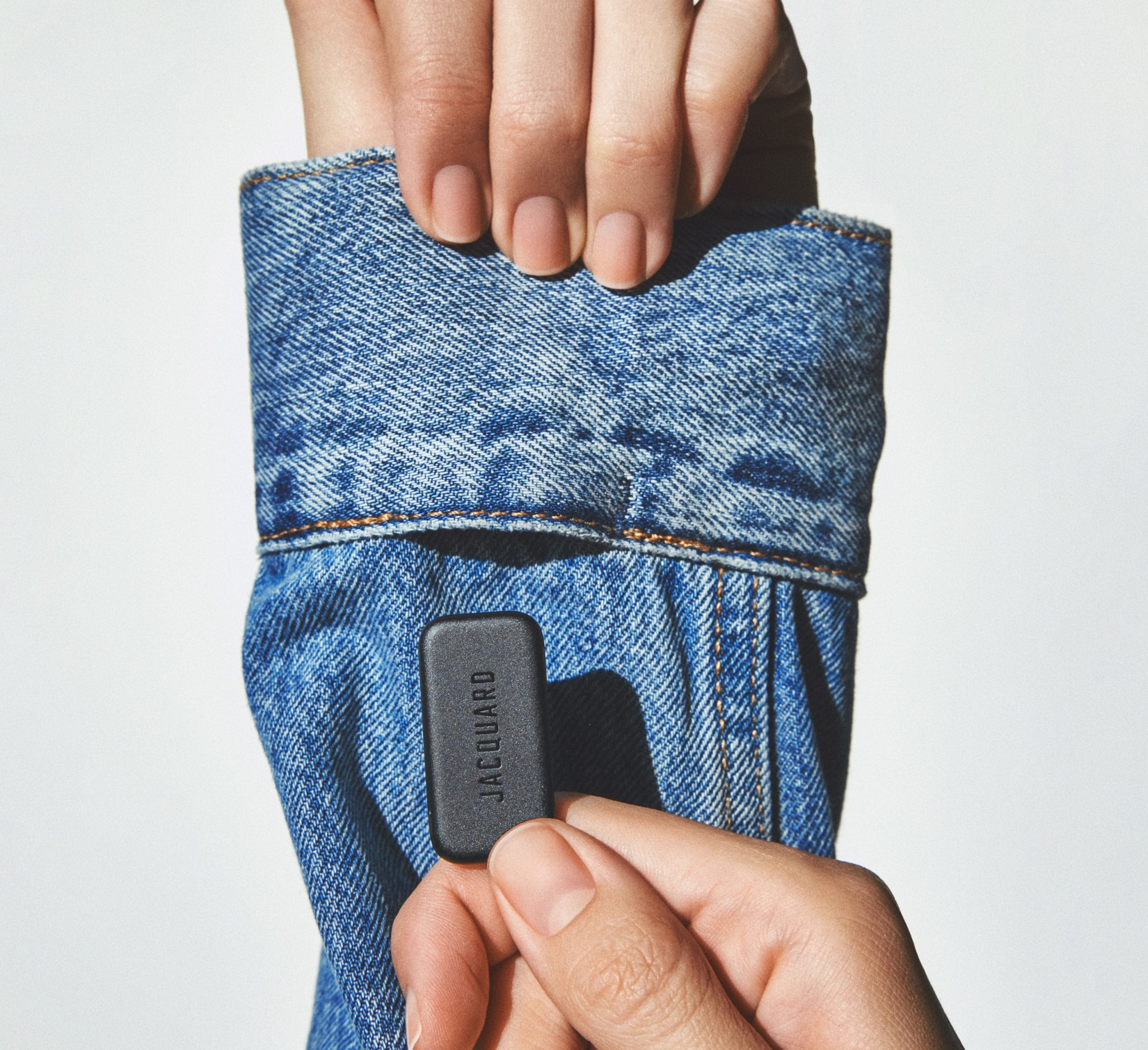 Featured image shows the Google Jacquard device being held against a denim sleeve. Image via Stratasys.