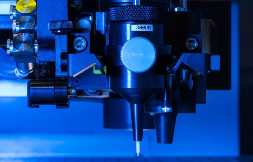 Closeup of the AJP Optomec 3D printing process. Photo via Optomec.
