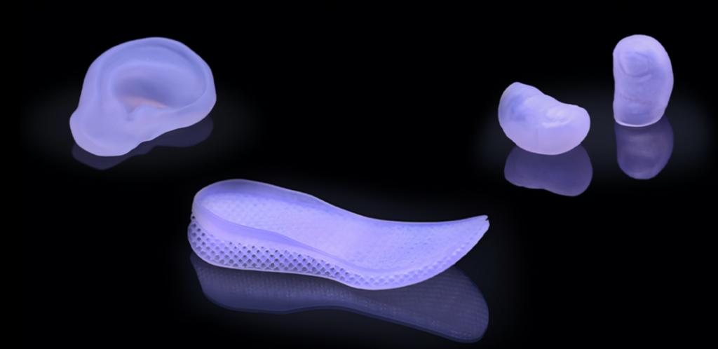 Orthotics and prosthetics 3D printed by Spectroplast. Photo via Spectroplast.