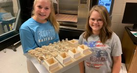 Dade County middle schoolers showcasing their ULTEM ISS parts. Photo via Dade County Middle School.