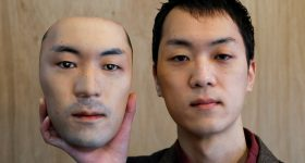 Shuhei Okawara, 30, holding a mask of his own face. Photo via Shuhei Okawara.
