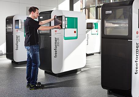A row of ARBURG Freeformer 200-3X 3D printers.
