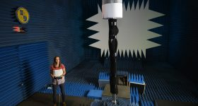 Engineer Anna Stumme making adjustments to an array inside the anechoic chamber at the NRL.