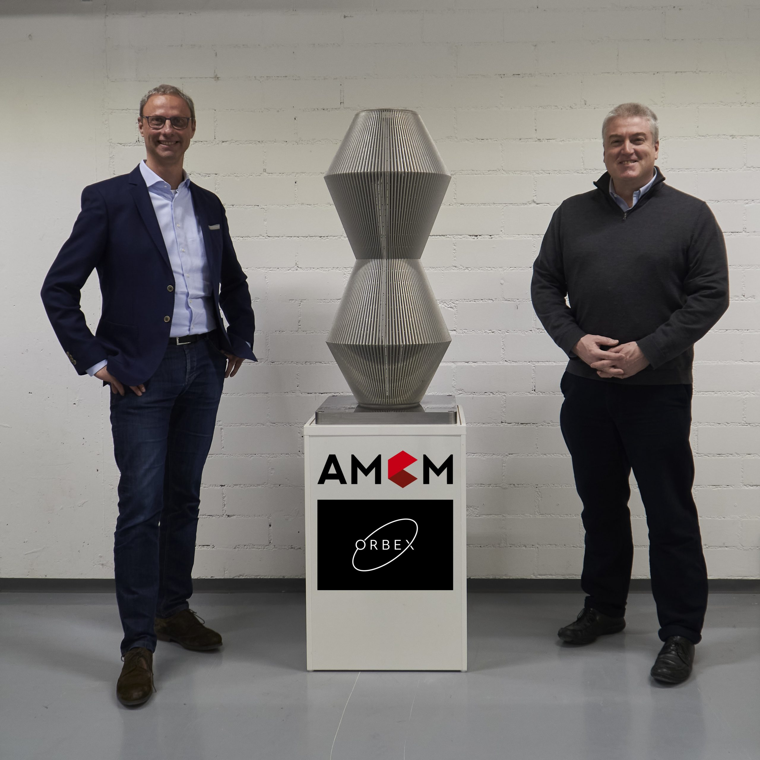 Martin Bullemer, Managing Director of AMCM (left) and Chris Larmour, CEO of Orbex (right). Photo via AMCM.