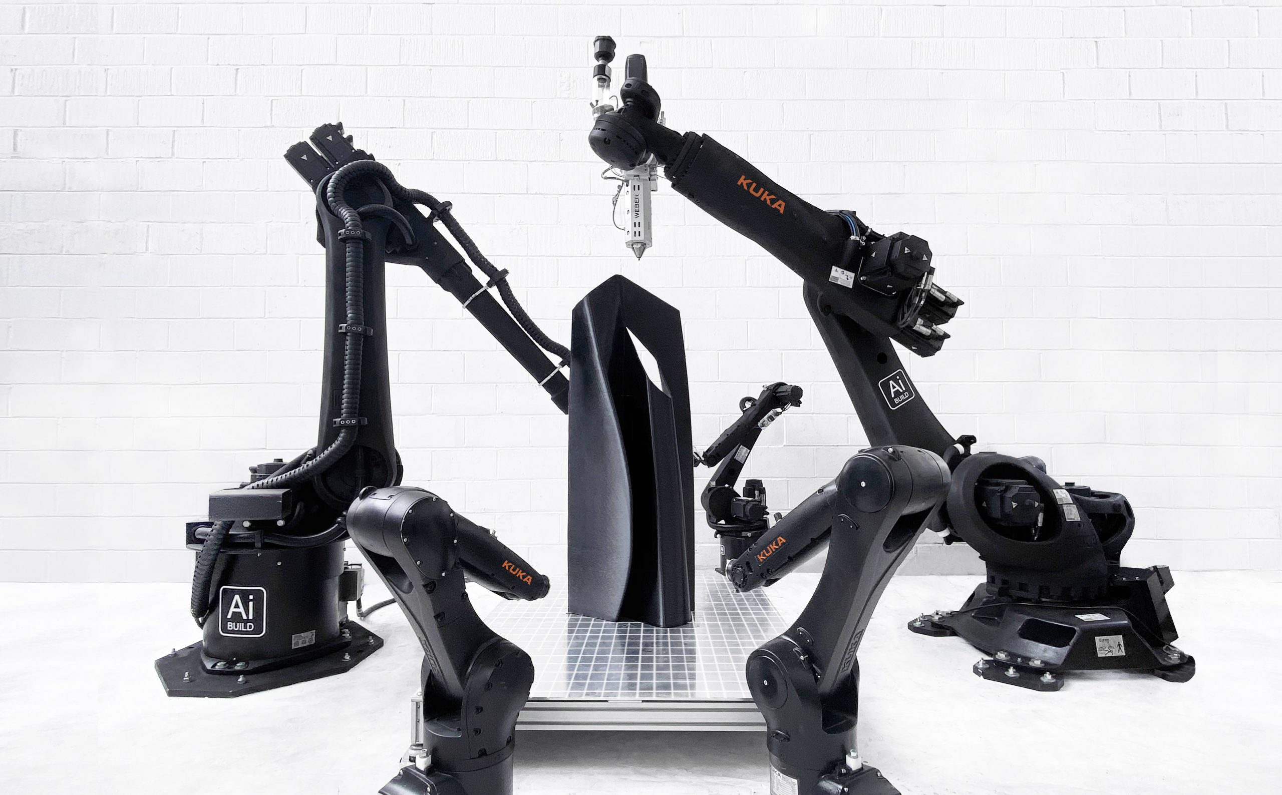 Ai Build's platform including its AiSync software, AiMaker robotic extruder, and AiCell heated chamber enclosure.