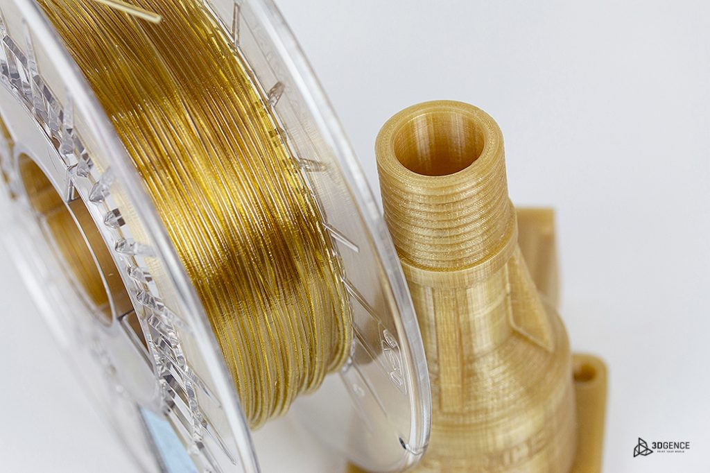 Close up of Kimya's PEKK filament next to 3D printed PEKK object. Photo via 3DGence.
