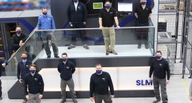A team of SLM engineers being trained in Lubeck to use the NXG XII 600 3D printer.