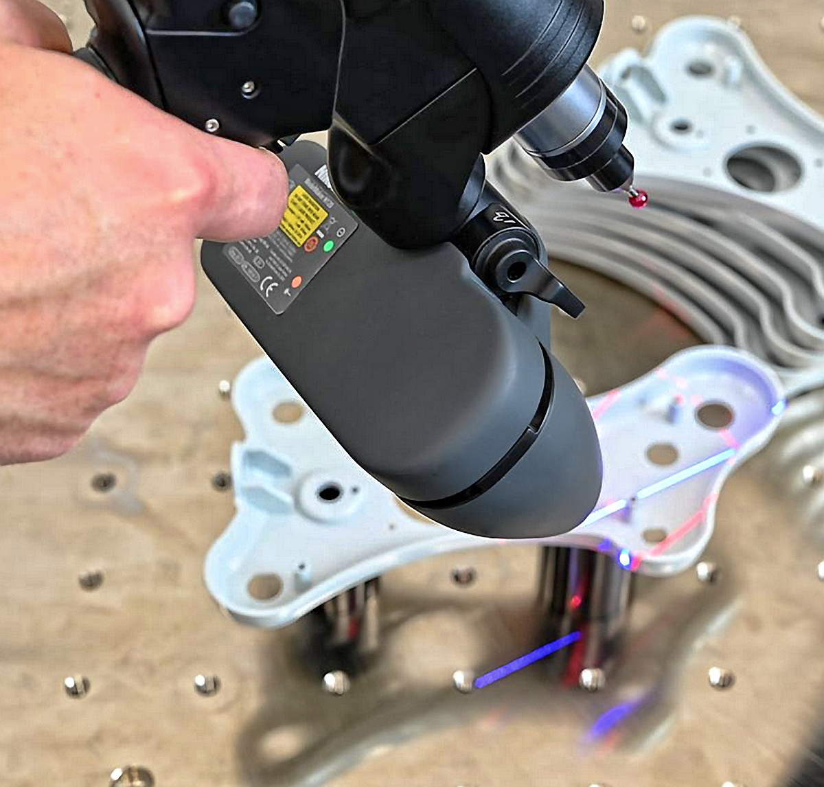 Close-up showing tactile probing and laser scanning with a FREEDOM ULTIMATE SCAN arm. Photo via LK Metrology.