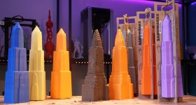3D printed sandcastle molds in blue, yellow, orange, brown, red, and purple, printed in PolyTerra PLA.