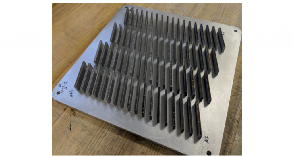 The 72 aluminum tensile bar samples used to evaluate the efficacy of the SOP. Photo via ORNL.